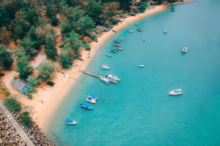 Water High Angle View Transportation Aerial View Land Beach Sea Mode Of Transportation Nautical Vessel Nature Day Tree Turquoise Colored Coastline Beauty In Nature Plant Scenics - Nature Outdoors Ship Sailboat No People Passenger Craft Yacht Bay