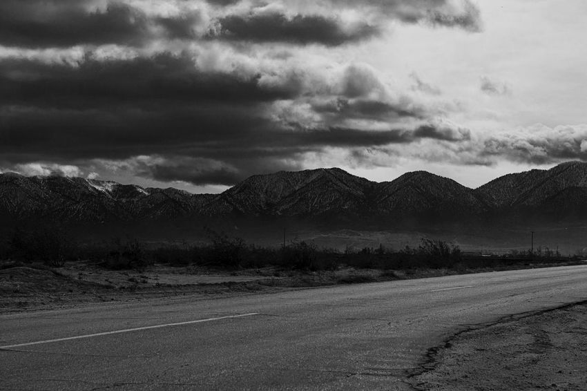 Dramatic Sky Moody Sky Silhouette Beauty In Nature Blackandwhite Close-up Cloud - Sky Clouds And Sky Contrast Landscape Monochrome Mountain Mountain Range Mountains Nature Outdoors Road Scenics Tranquility