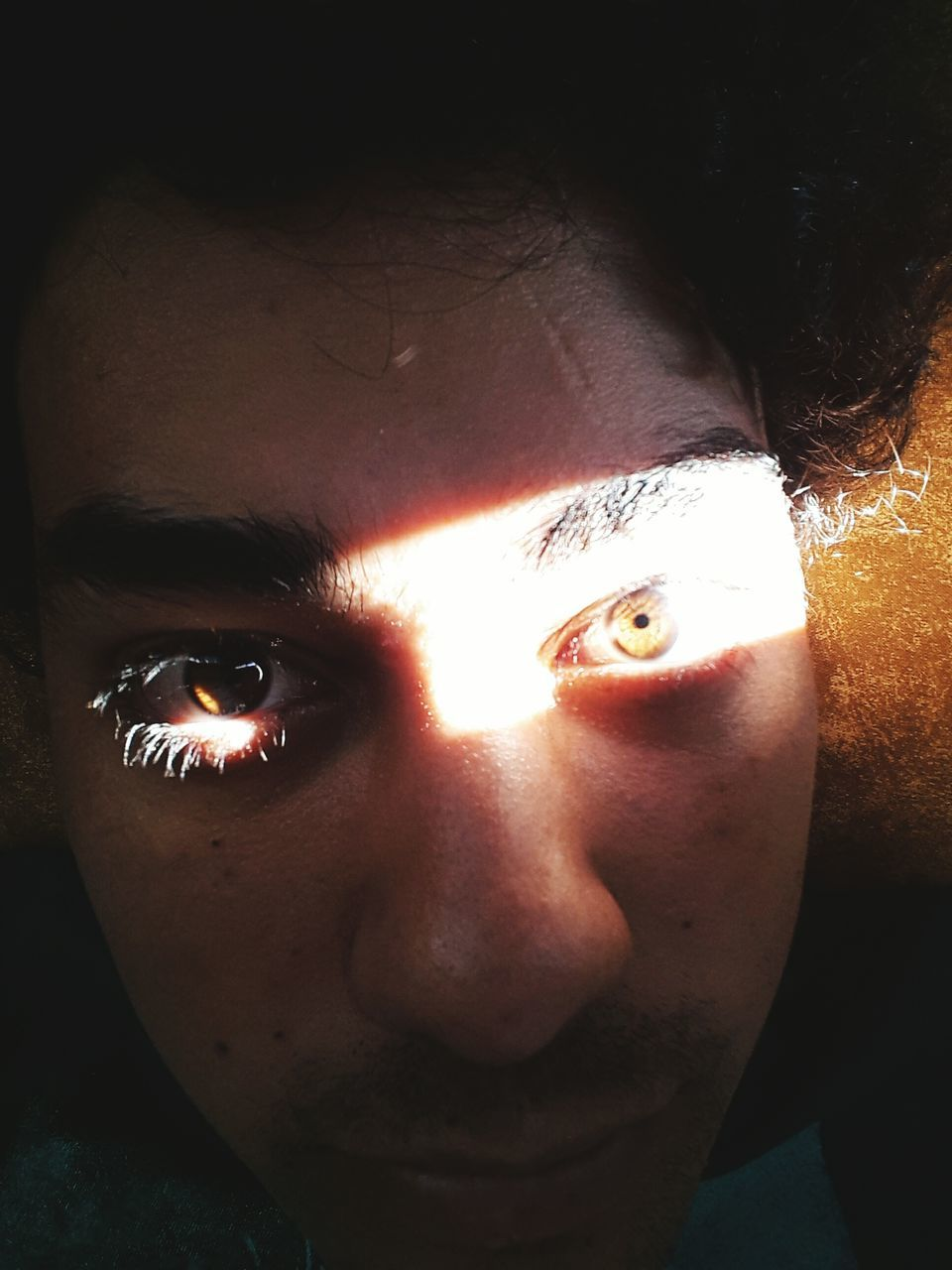 real people, one person, close-up, looking at camera, leisure activity, young adult, human face, portrait, human eye, men, indoors, day, eyeball, people