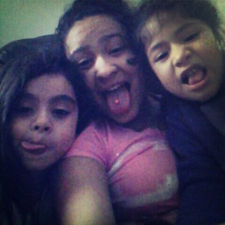 Silly faces with my babies :) Natalie & Isha