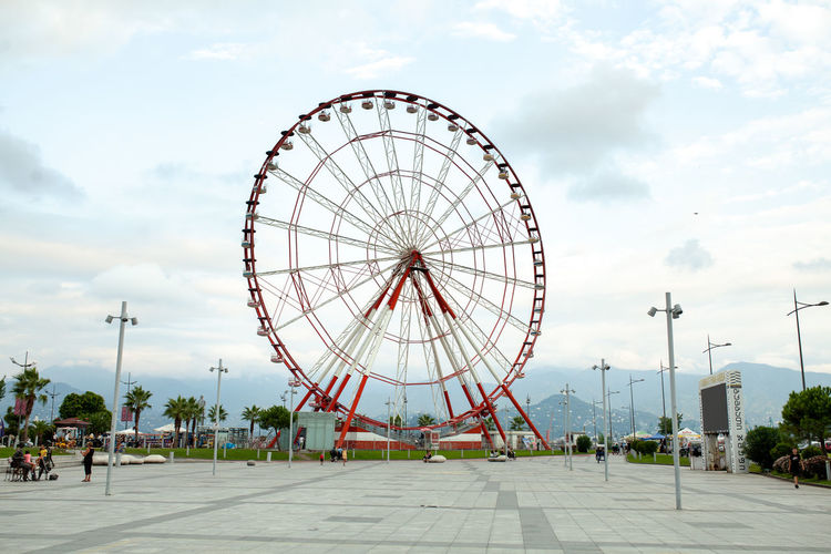 Ferris Wheel at the Batumo Georgia 2018 Batumi Summer Georgia Cloud - Sky Amusement Park Sky Amusement Park Ride Ferris Wheel Arts Culture And Entertainment Architecture Day Nature Built Structure Incidental People City Building Exterior Street Circle Tree Shape Geometric Shape Outdoors Travel Destinations