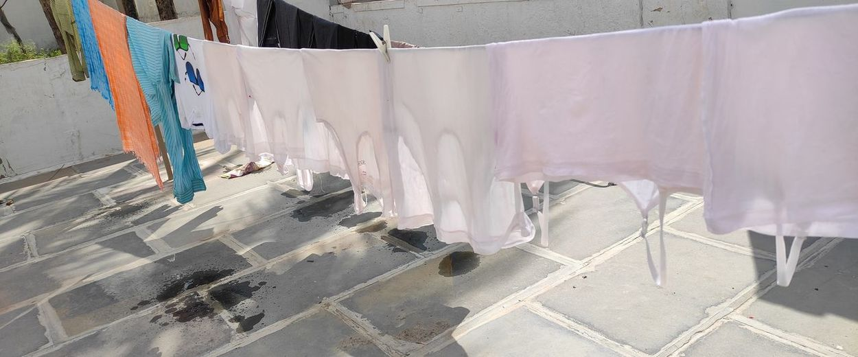High angle view of clothes drying on concrete wall