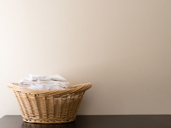 Laundry in wicker basket Absence Basket Chores Clean Container Copy Space Domestic Life Domestic Room Housework Hygiene Indoors  Laundry Laundry Basket No People Paper Still Life Studio Shot Wall - Building Feature White Color Wicker