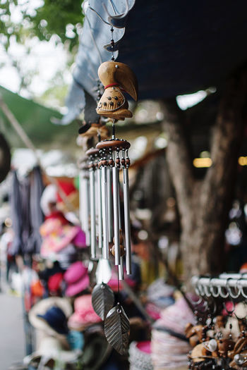 Close-up of wind chime hanging for sale in market