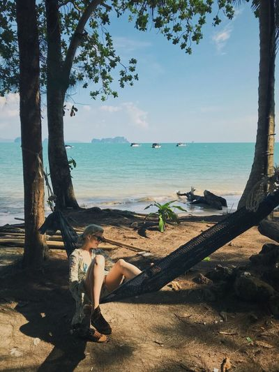 Miss clumsy Backpackingthailand Islandlife Island Kohyaonoi Thailand Hammock Sea Tree Horizon Over Water Water Beauty In Nature Beach Nature One Person Full Length Tree Trunk Scenics Sky Outdoors Day Rope Swing People Young Adult