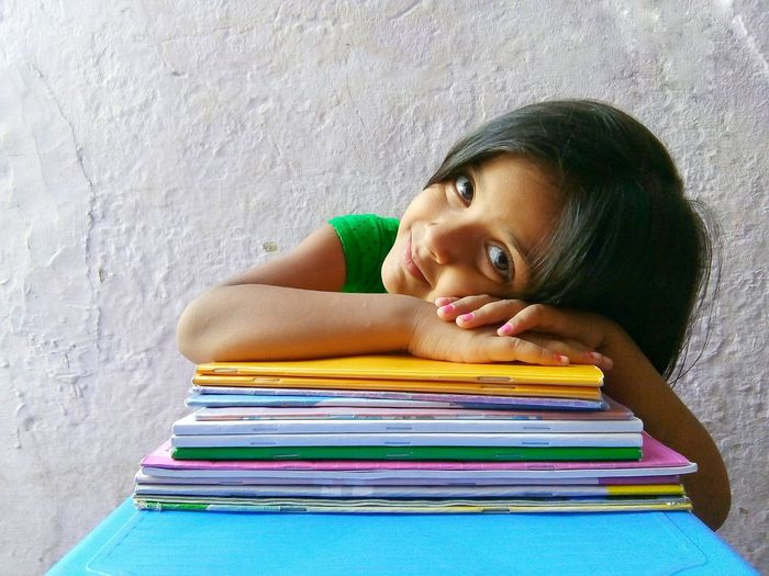 cute girl child with books Kid Girl Smiling Looking At Camera Window Light Sunlight Smile Cuteness Happiness Education Knowledge Books Young Girl Childhood Indian Child Childhood Facial Expression Portrait Thoughtful Thinking Elementary School Elementary Student SchoolGirl Back To School Homework