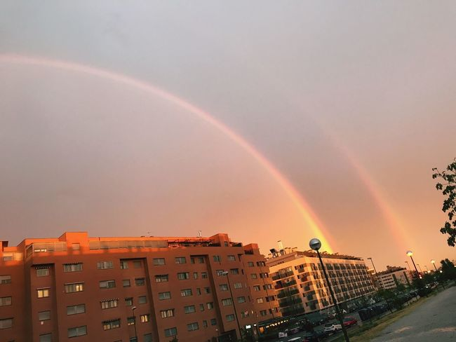 Rainbow Building Exterior Architecture Built Structure Double Rainbow City Outdoors No People Sunset Sky Beauty In Nature Scenics Cityscape Clear Sky Nature Multi Colored Day Double Rainbows