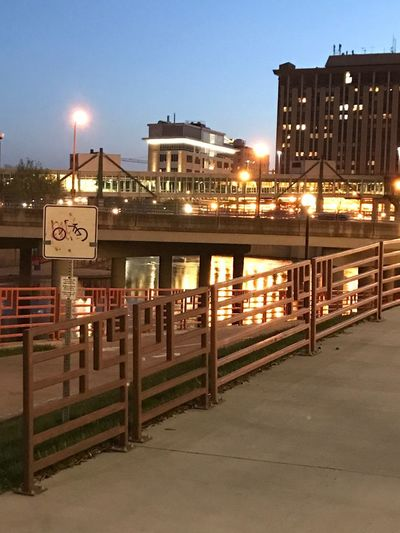 Take a seat, soak it all in Architecture Built Structure Building Exterior Sky Illuminated City Transportation Sign Lighting Equipment Clear Sky Dusk Communication Street Light Water Text Street Building Nature No People Railing