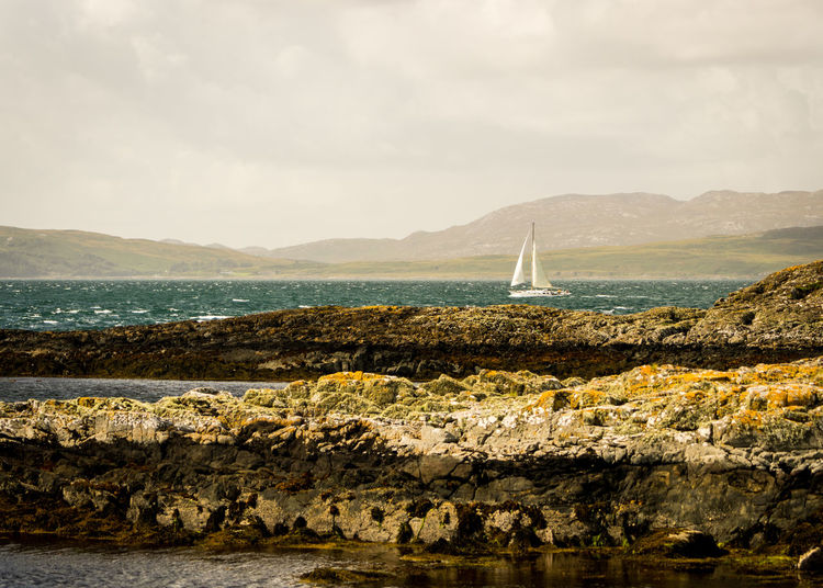 Scotland Stormy Weather Beauty In Nature Cloud - Sky Coast Day Island Mode Of Transportation Mountain Nature Nautical Vessel No People Outdoors Rock Rock - Object Sailboat Scenics - Nature Sea Sky Tayvallich Tranquil Scene Tranquility Transportation Travel Water