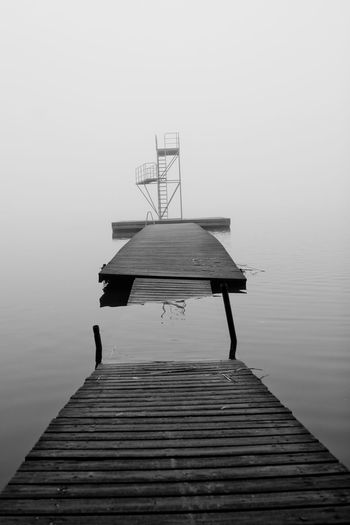 High angle view of broken pier in lake