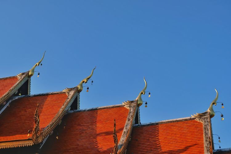 Wat ket karam in Chiang mai Travel Destinations Blue Sky Temple Roof Beautiful Chiang Mai | Thailand Wat Ket Karam Roof Red Clear Sky Sky Architecture Building Exterior Roof Tile High Section Rooftop