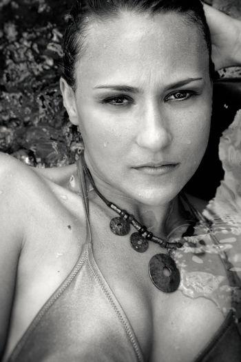 Close-up portrait of sensuous woman in sea