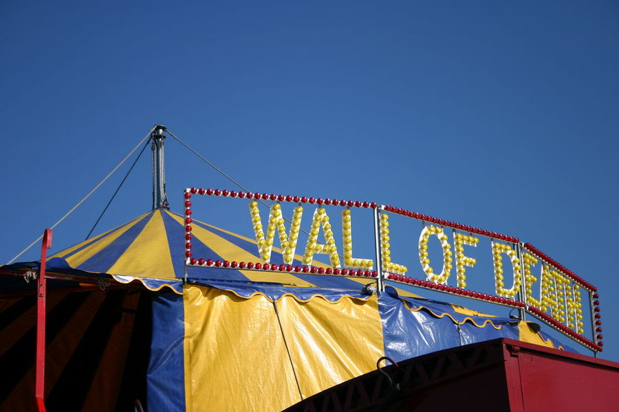 Blue Circus Tent Clear Sky Day Event Hanging High Section Low Angle View Multi Colored No People Tourism Wall Of Death