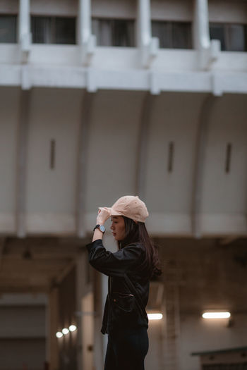 Portrait Portrait Of A Woman Portrait Photography Portrait Of A Girl Cap Watch Sports Clothing Warm Clothing Illuminated Young Women Built Structure Architecture Office Building Head And Shoulders