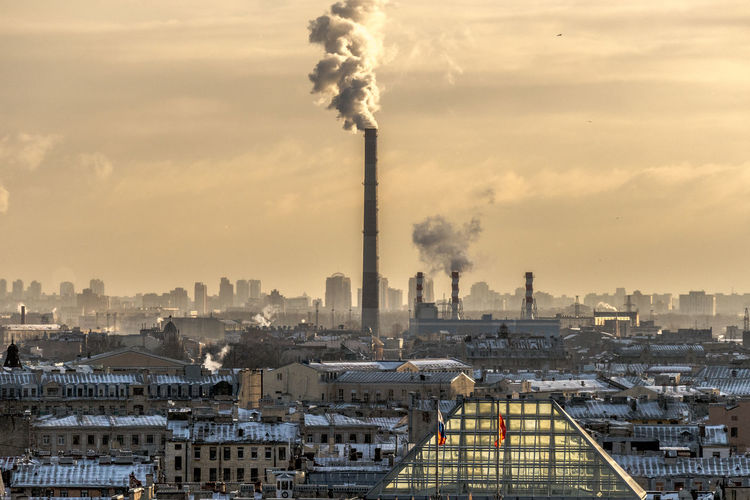 Air Pollution Architecture Building Exterior Built Structure Chimney City Cityscape Day Ecosystem  Emitting Environment Factory Fumes Industry No People Outdoors Pollution Sky Smoke - Physical Structure Smoke Stack