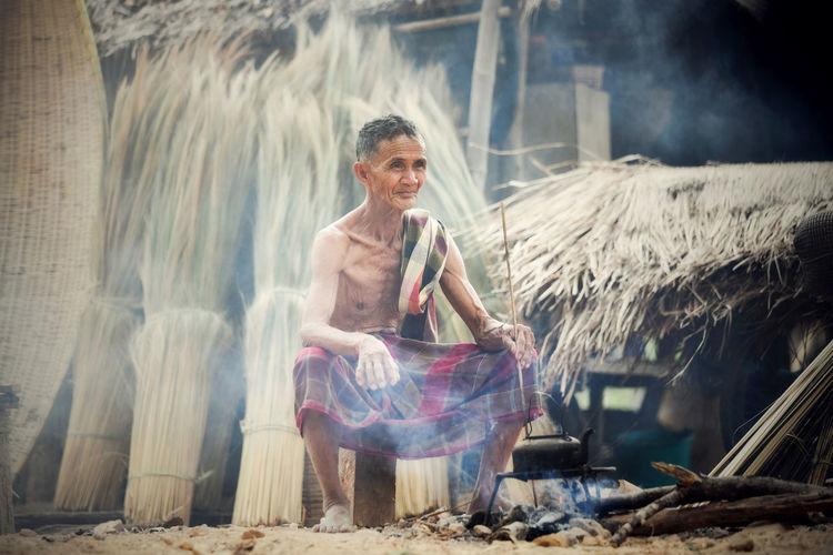 Smiling man sitting outdoors