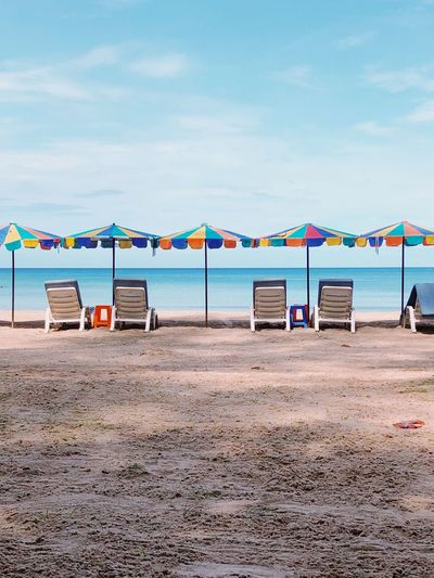 Umbrellas and sun beds on the beach. Sand and sea. Morning December 10, 2018 Calming Place Calm Sea Calm Sun Beds Near The Sea Sun Beds Blue Sea Beach Sand And Sea Sea And Sky Umbrellas Beach Water Sky Land Sand Sea Cloud - Sky Nature Scenics - Nature Horizon Horizon Over Water Multi Colored Beauty In Nature