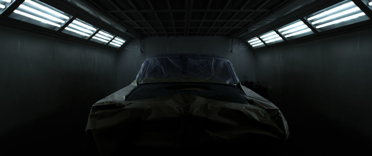 Covered car in garage