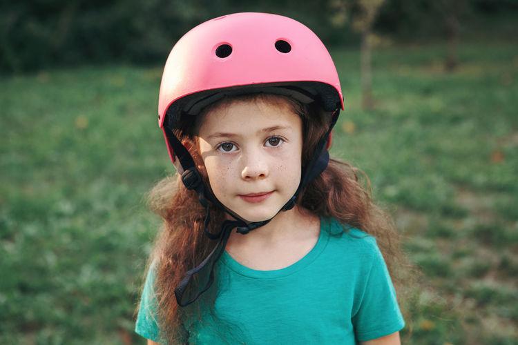Portrait of cute girl wearing crash helmet