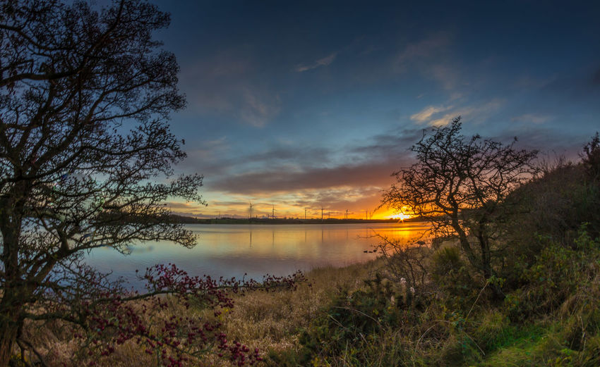 Just another sunset. Arrival Beauty Extreme Weather Flood Grass Igniting Lake Landscape Nature No People Outdoors Sky Sunset Tourism Travel Tree Vacations Water