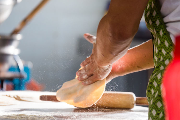 Low section of man making chapatti