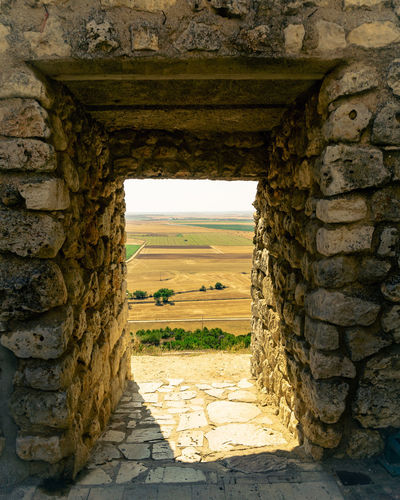 Day Daylight Outdoors Architecture Built Structure Wall Stone Wall No People Wall - Building Feature Nature Plant Solid Landscape Stone Material Land Field History Entrance The Past Old Rural Scene Brick Ancient Civilization Capture Tomorrow
