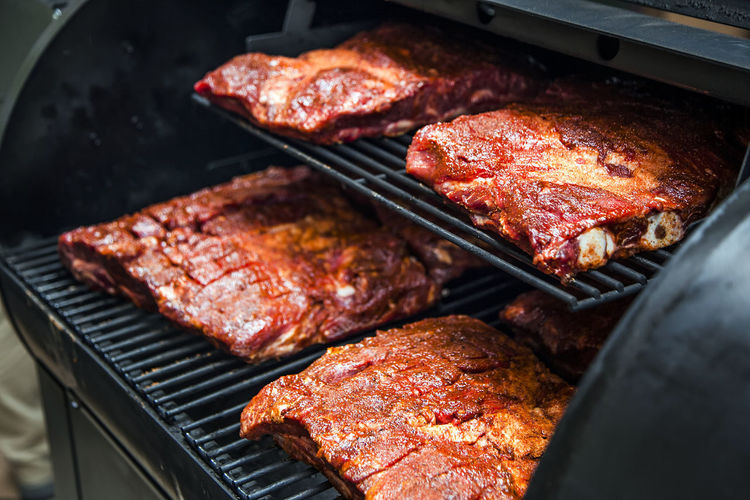 High Angle View Of Beef Ribs Cooking In Barbecue Grill