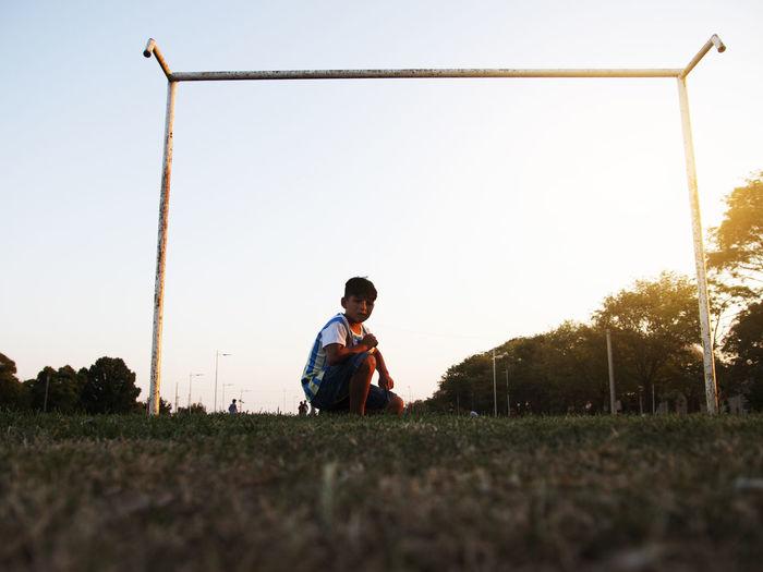 Little child goalkeeper in soccer field