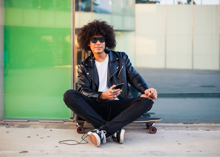 Young man sitting in sunglasses