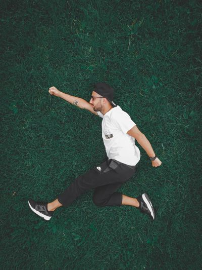 Man Grass Green Color High Angle View Lying Down One Person Leisure Activity Full Length Real People Limb Casual Clothing Nature Human Arm Day Lifestyles Arms Outstretched Sunlight Outdoors Enjoyment Directly Above Arms Raised The Art Of Street Photography