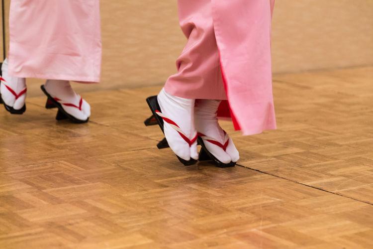 Low Section Of Women Dancing On Hardwood Floor