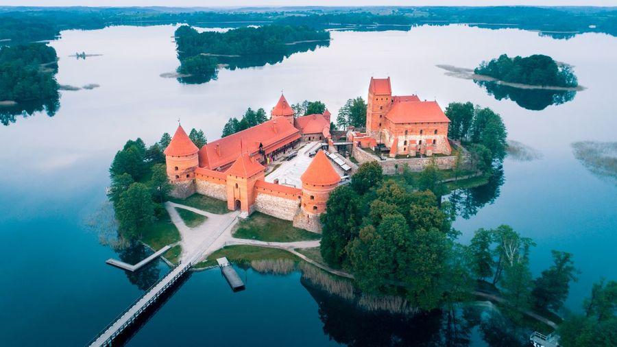 Trakai Island Castle Aerial View Shot Drone  Island Lake Lithuania Lietuva Beautiful Vilnius Medieval Panoramic Aerial Photography Travel Blue Trakai Water Aerial View River History Architecture Building Exterior Castle Medieval Fortress Archaeology Ancient Aged Fort Old Ruin
