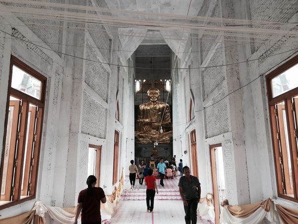 Buddha space Architecture Built Structure Lifestyles Real People Religion Place Of Worship Tourism Women Travel Destinations Men Spirituality Entrance Building Exterior Leisure Activity Indoors  Large Group Of People Day People Buddha