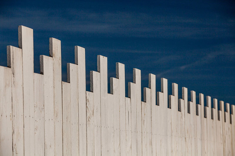 Close-up of wooden wall against sky