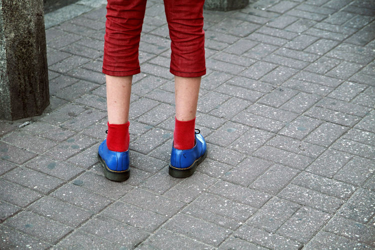 A youngster sports blue shoes and red socks whilst travelling around Poznan in Poland. Blackandwhite Blue Blue Shoes Dr Martens Boots Eccentric Trendy Look Teenager Bright Hipster Human Body Part Human Leg Low Section One Person Outdoors People Real People Red Red Socks Standing Tourist Poland Poznań EyeEmNewHere Fresh On Market 2017
