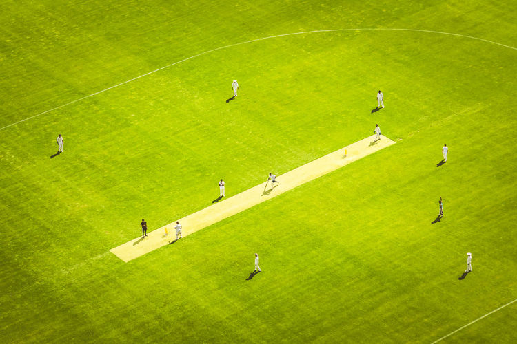 High angle view of cricketers playing on ground
