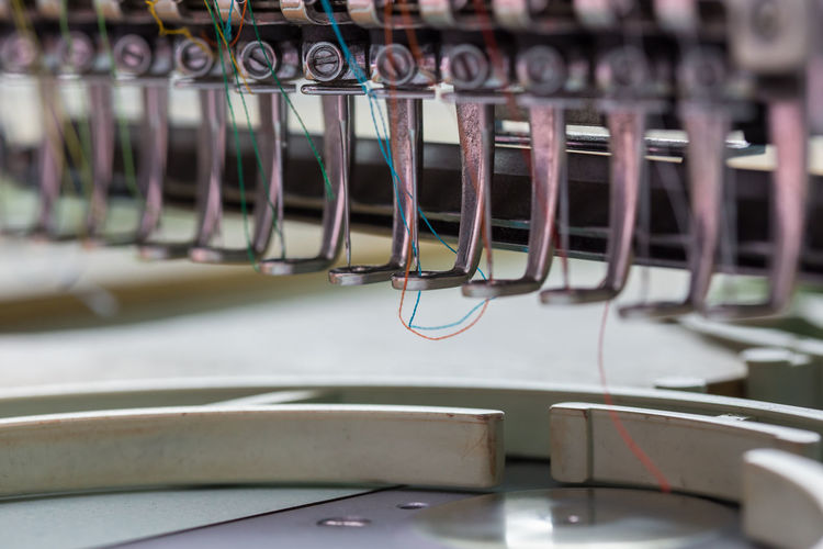 Close-up of colorful threads in sewing machine