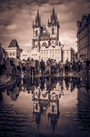 Church of Our Lady before Tyn reflected in the puddle on rainy summer day Bohemia Church Of Our Lady Before Tyn City Czech Republic Gothic Gothic Architecture Prague Rain Travel Architecture Building Building Exterior Built Structure Church Of Our Lady Cloud - Sky Group Of People Monochrome Place Of Worship Puddle Rainy Day Reflection Religion Spirituality Travel Destinations Water