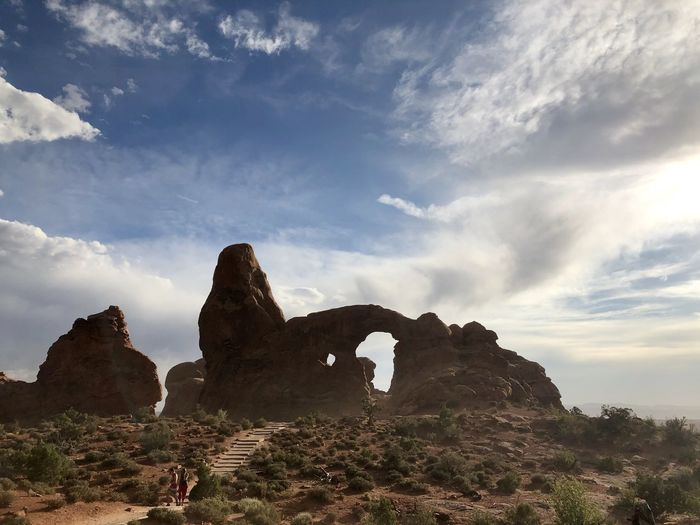 Low angle view of rock formations against sky, arches national park