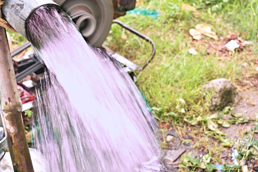 water on speed shots Bicycle Close-up Day Equipment Field Flowering Plant Focus On Foreground Front Or Back Yard Grass Growth High Angle View Land Land Vehicle Nature No People Outdoors Pink Color Plant Purple Selective Focus Textile Wheel