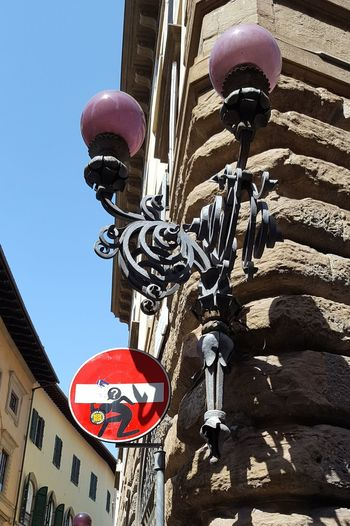 Firenze Florence Italia Italy Low Angle View Architectural Detail Light And Shadow No People Clet Clet Abraham Street Art City Communication Red Architecture Building Exterior Sky Built Structure Graffiti Road Sign