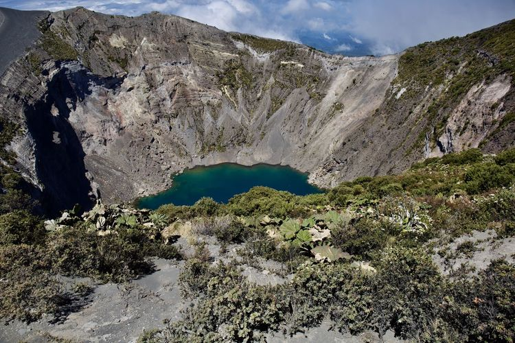 Mountain Beauty In Nature Scenics - Nature Non-urban Scene Nature Water Tranquil Scene Tranquility Geology Physical Geography No People Day Rock Mountain Range Lake Landscape Environment Sky Rock - Object Outdoors Volcanic Crater Formation Power In Nature Eroded
