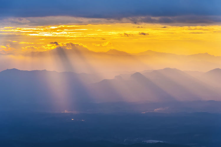Nature background. Ray light at mountain in sunset. Fantasy sky scene. Amazing nature background. Picture for add text message. Backdrop for design art work. Amazing Autumn Background Beams Beautiful Blue Cloud Colorful Dawn Dusk Environment Evening Fantasy Gold Heaven Hill Horizon Landscape Light Majestic Morning Mountain Natural Nature Orange Outdoor Ray Red Rural Scene Scenic Season  Sky Skyline Summer Sun Sunbeam Sunlight Sunny Sunrise Sunset Sunshine Tourism Travel Twilight Valley View Wallpaper Wonderland Yellow