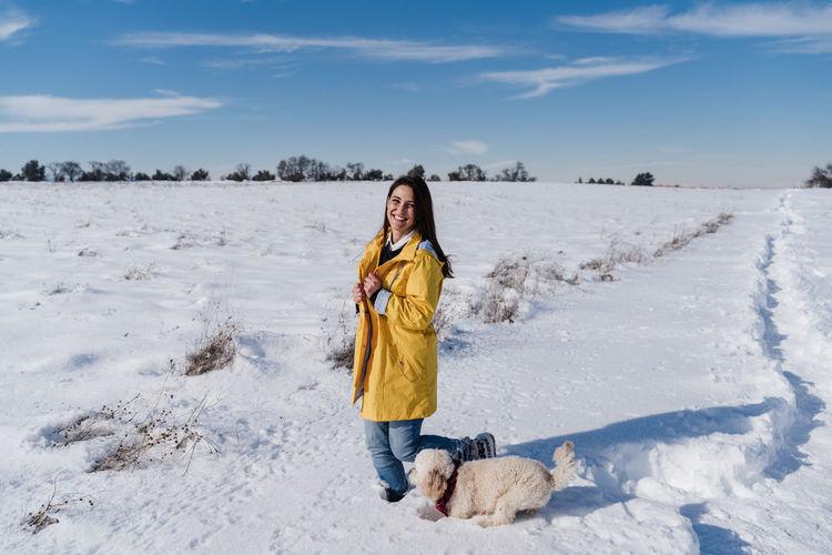 Full length of a dog on snow