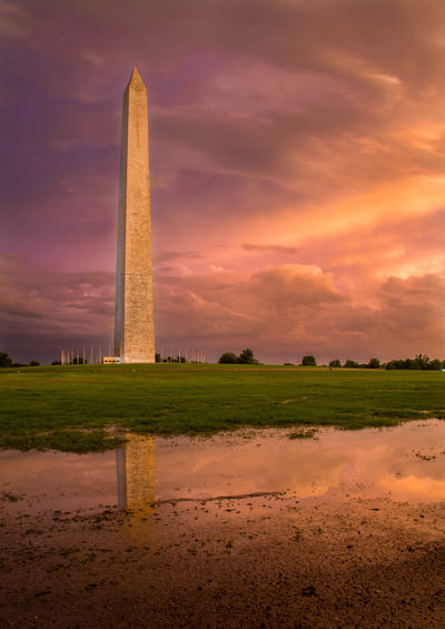 Storm Clears over the Washington Monument Atmosphere Clouds Dramatic Sky Famous Place Low Angle View Monument Outdoors Rain Reflection Silhouette Storm Sunset Tower Washingtonmonument