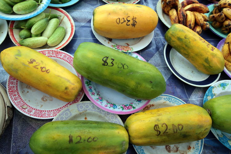 High angle view of price written on papayas for sale at market