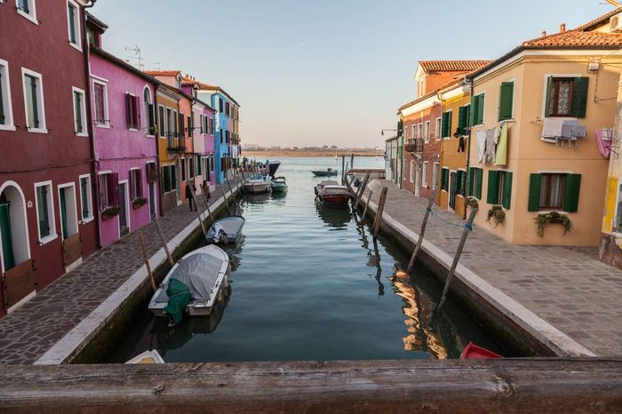 Architecture Building Exterior Built Structure Burano Clear Sky Day Italy Mode Of Transport Moored Nature Nautical Vessel No People Outdoors Sea Sky Tourism Tourism Destination Transportation Travel Destinations Venice, Italy Water Wooden Post