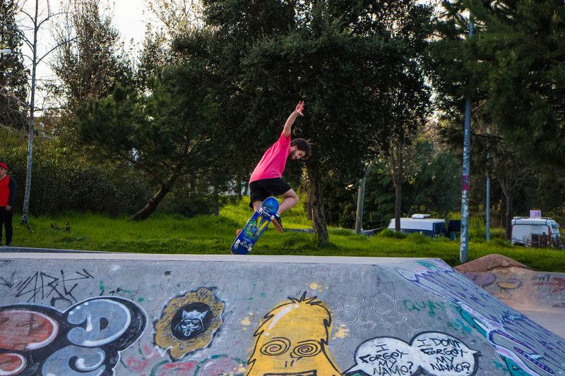 Full length of girl jumping on skateboard