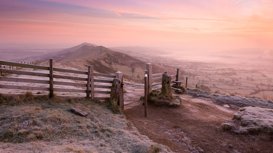 Mam Tor iconic gate at sunrise Castleton Mam Tor Gate Misty Peak District Northern England Beauty In Nature Cold Temperature Fence Frosty Mornings Golden Hour Hope Valley Inversion Landscape Mam Tor Mist Misty Morning Nature Open Gate Outdoors Peak District  Peak District National Park Ridge Scenics Sunrise Tranquil Scene Valley