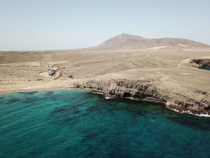 Aerial view of coastline against sky
